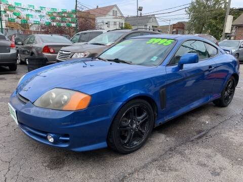 2004 Hyundai Tiburon for sale at Barnes Auto Group in Chicago IL