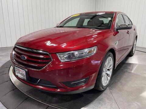 2014 Ford Taurus for sale at HILAND TOYOTA in Moline IL