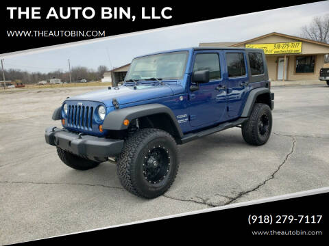 2010 Jeep Wrangler Unlimited for sale at THE AUTO BIN, LLC in Broken Arrow OK