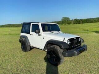 2015 Jeep Wrangler for sale at CAVENDER MOTORS in Van Alstyne TX