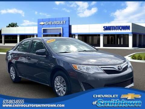 2014 Toyota Camry for sale at CHEVROLET OF SMITHTOWN in Saint James NY