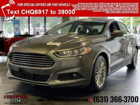 2014 Ford Fusion for sale at CERTIFIED HEADQUARTERS in Saint James NY