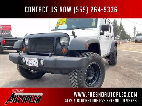 2013 Jeep Wrangler Unlimited for sale at Carros Usados Fresno in Clovis CA