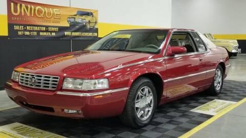 1999 Cadillac Eldorado for sale at UNIQUE SPECIALTY & CLASSICS in Mankato MN