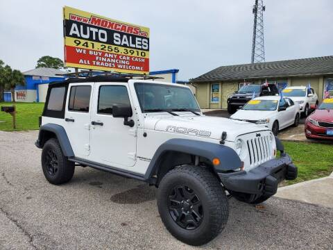 2013 Jeep Wrangler Unlimited for sale at Mox Motors in Port Charlotte FL