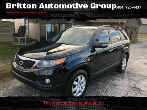 2011 Kia Sorento for sale at Britton Automotive Group in Loganville GA
