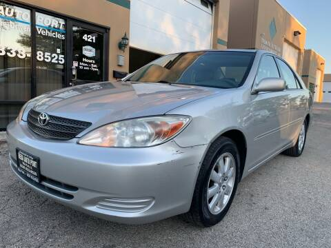 2002 Toyota Camry for sale at REDA AUTO PORT INC in Villa Park IL