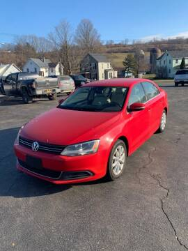 2013 Volkswagen Jetta for sale at WXM Auto in Cortland NY