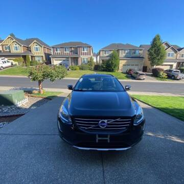 2015 Volvo XC60 for sale at Road Star Auto Sales in Puyallup WA