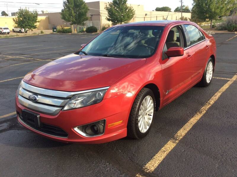 2012 Ford Fusion Hybrid for sale at AROUND THE WORLD AUTO SALES in Denver CO