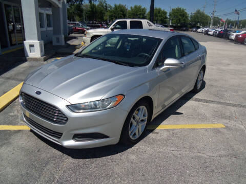 2014 Ford Fusion for sale at ORANGE PARK AUTO in Jacksonville FL