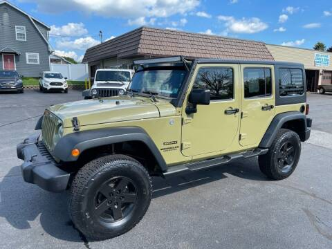 2013 Jeep Wrangler Unlimited for sale at MAGNUM MOTORS in Reedsville PA