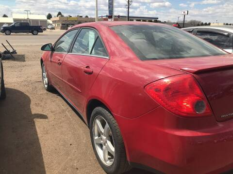 2008 Pontiac G5 for sale at BARNES AUTO SALES in Mandan ND