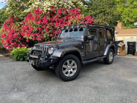 2017 Jeep Wrangler Unlimited for sale at The Car Store in Milford MA