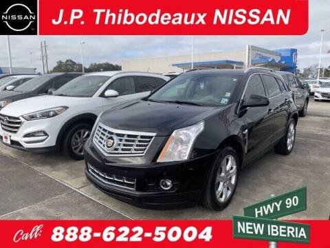 2014 Cadillac SRX for sale at J P Thibodeaux Used Cars in New Iberia LA