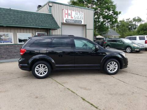2014 Dodge Journey for sale at H & L AUTO SALES LLC in Wyoming MI
