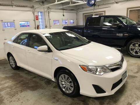 2014 Toyota Camry Hybrid for sale at Carney Auto Sales in Austin MN