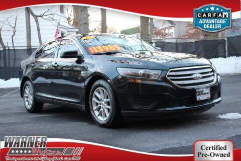 2015 Ford Taurus for sale at Warner Motors in East Orange NJ