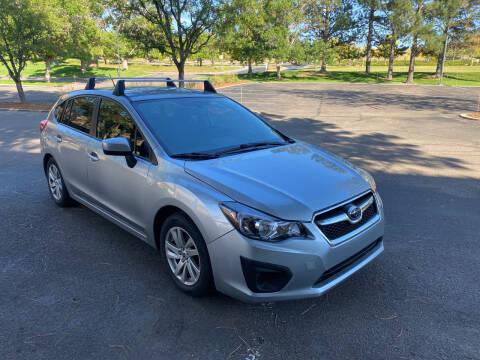 2016 Subaru Impreza for sale at QUEST MOTORS in Englewood CO