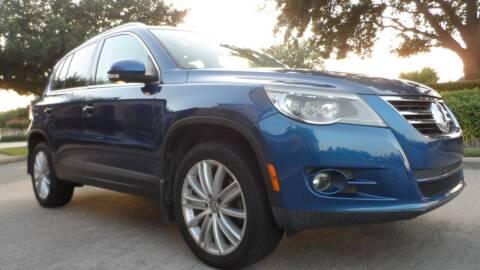 2009 Volkswagen Tiguan for sale at Exhibit Sport Motors in Houston TX
