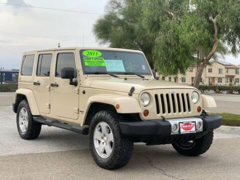 2011 Jeep Wrangler Unlimited for sale at Esquivel Auto Depot in Rialto CA