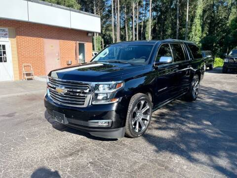 2015 Chevrolet Suburban for sale at Magic Motors Inc. in Snellville GA