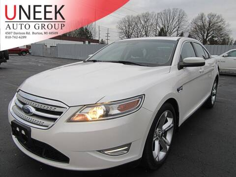 2010 Ford Taurus for sale at Uneek Auto Group LLC in Burton MI