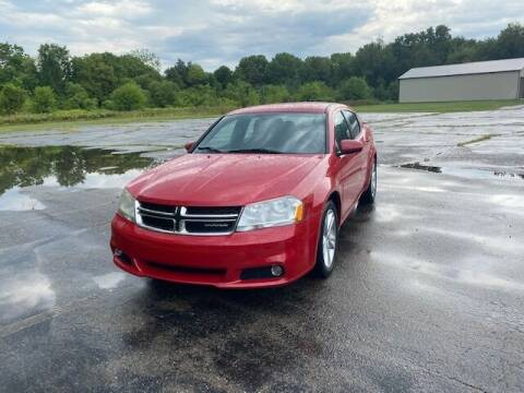 2011 Dodge Avenger for sale at Caruzin Motors in Flint MI