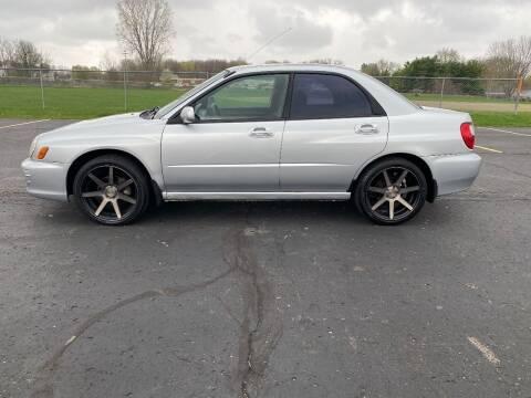 2002 Subaru Impreza for sale at Caruzin Motors in Flint MI