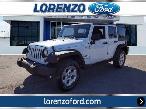 2012 Jeep Wrangler Unlimited for sale at Lorenzo Ford in Homestead FL