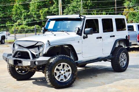2014 Jeep Wrangler Unlimited for sale at Marietta Auto Mall Center in Marietta GA
