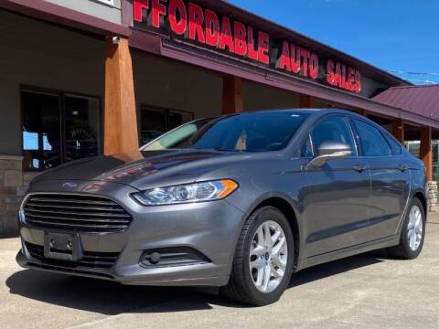 2014 Ford Fusion for sale at Affordable Auto Sales in Cambridge MN