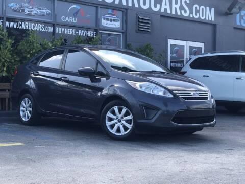 2012 Ford Fiesta for sale at CARUCARS LLC in Miami FL