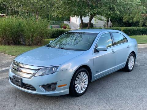 2011 Ford Fusion Hybrid for sale at Triangle Motors Inc in Raleigh NC