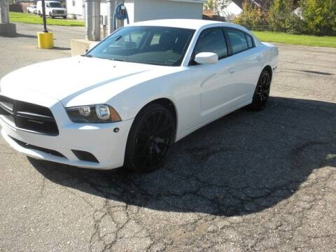 2013 Dodge Charger for sale at MASTERS AUTO SALES in Roseville MI