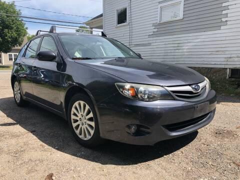 2011 Subaru Impreza for sale at Specialty Auto Inc in Hanson MA