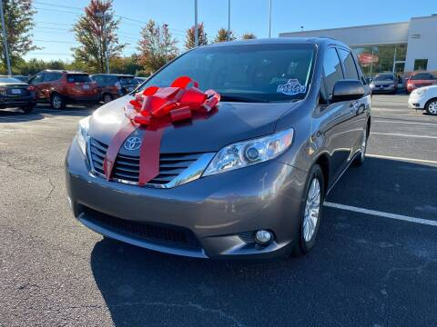 2014 Toyota Sienna for sale at Charlotte Auto Group, Inc in Monroe NC