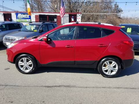 2012 Hyundai Tucson for sale at Howe's Auto Sales in Lowell MA