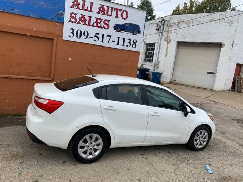 2014 Kia Rio for sale at Ali Auto Sales in Moline IL