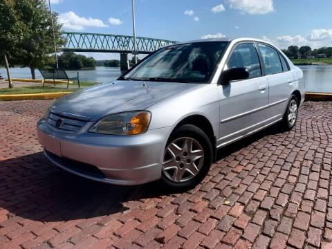 2003 Honda Civic for sale at PUTNAM AUTO SALES INC in Marietta OH