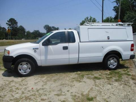 2008 Ford F150 Pickup with Work Topper a