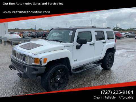 2006 HUMMER H3 for sale at Out Run Automotive Sales and Service Inc in Tampa FL