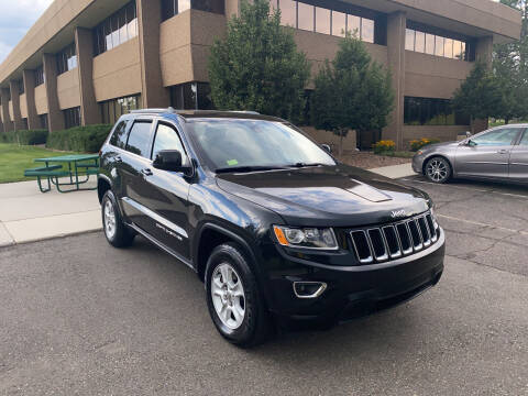 2015 Jeep Grand Cherokee for sale at QUEST MOTORS in Englewood CO