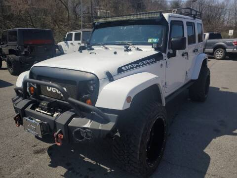 2013 Jeep Wrangler Unlimited for sale at Mulligan's Auto Exchange LLC in Paxinos PA