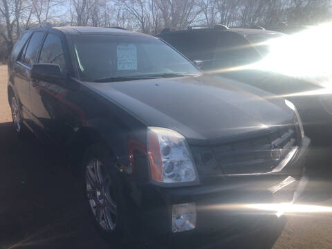 2009 Cadillac SRX for sale at BARNES AUTO SALES in Mandan ND