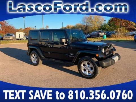 2010 Jeep Wrangler Unlimited for sale at Lasco of Grand Blanc in Grand Blanc MI