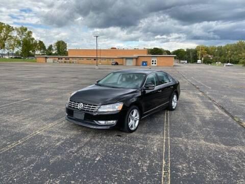 2014 Volkswagen Passat for sale at Caruzin Motors in Flint MI