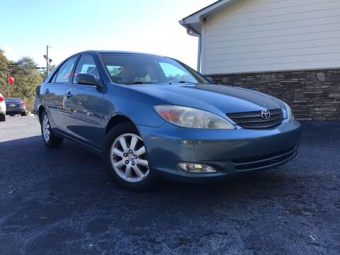 2003 Toyota Camry for sale at No Full Coverage Auto Sales in Austell GA