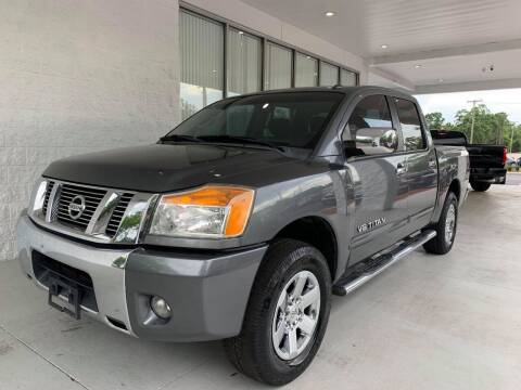 2013 Nissan Titan for sale at Powerhouse Automotive in Tampa FL