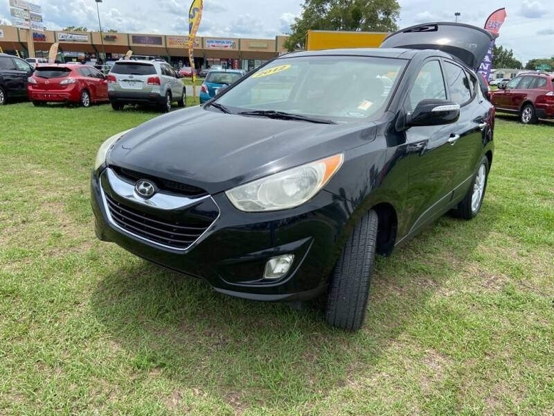 2012 Hyundai Tucson for sale at Unique Motor Sport Sales in Kissimmee FL